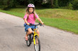 little girl learning to ride a bicycle