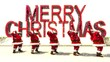 5 Santas Dancinbg with Merry Cristmas text.. Loop