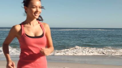 Attractive woman running on the beach