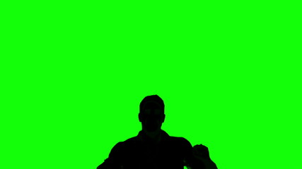 Silhouette of jumping man on green screen