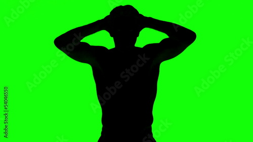 Silhouette of a man tensing arms on green screen