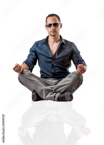 Young fashion man sitting on white background
