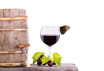 grapes on a barrel with corkscrew, butterfly and wine glass