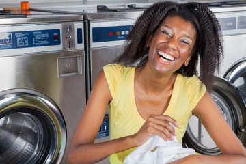 Cheerful Woman With Clothes In Laundry