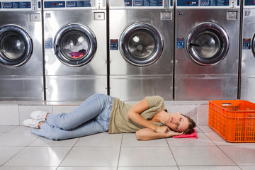 Woman Listening Music While Resting In Laundry