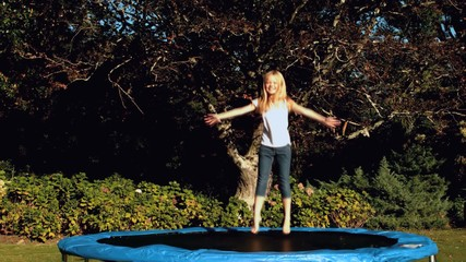 Little girl having fun on a trampoline
