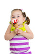funny kid girl eating ice cream isolated