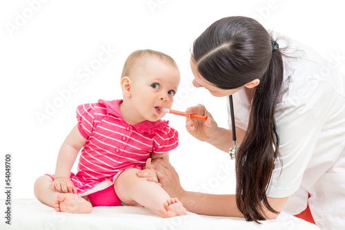 doctor giving remedy to kid girl isolated on white