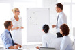 business team working with flip chart in office
