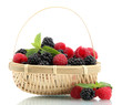 beautiful berries with leaves in basket isolated on white