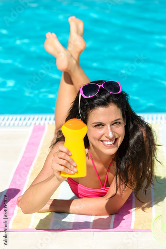 Woman summer sunbathing and suntan lotion