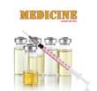 Medical bottles and syringe on light gray tone