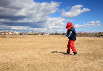 girl practising a golf swing