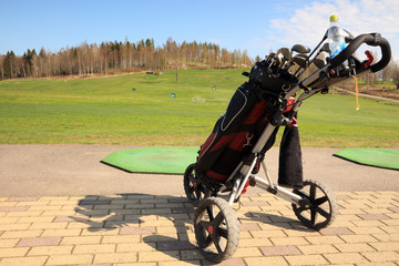 golf bag and trolley on  driving ranch