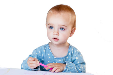Little girl sitting with color pen
