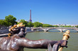 Eiffel Tower, artistic statue and bridge on Seine river Paris, F