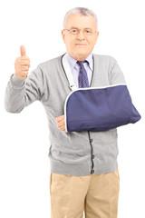 Senior man with broken arm giving thumb up