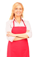 Smiling mature female worker wearing an apron