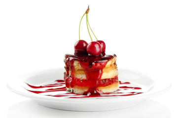 Tasty biscuit cake with jam and berries