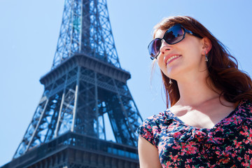 Young attractive woman against Eiffel Tower, Paris, France