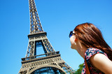 Young attractive woman looking at Eiffel Tower, Paris, France