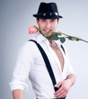 Valentines man in hat with rose
