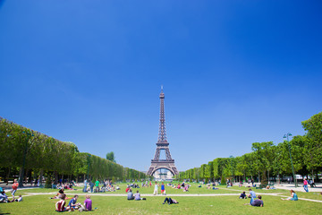 Eiffel Tower, Paris, France. Tourists and localson Champ de Mars