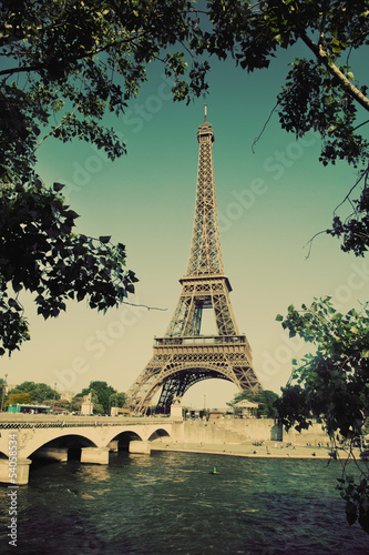 Eiffel Tower and bridge on Seine river in Paris, France. Vintage - 54058534