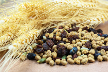 dried cereal and fruits with stalks of wheat ears