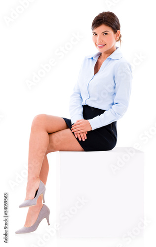 Beautiful business woman sitting