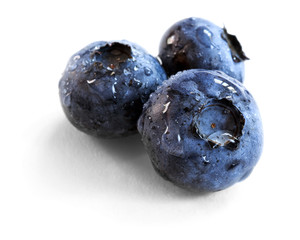 blueberries over white background