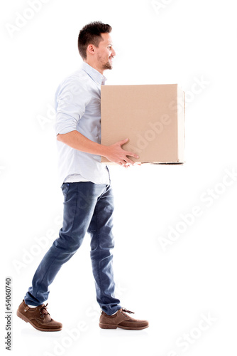 Business man carrying a box