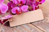 Fototapety Orchideen und leeres Schild