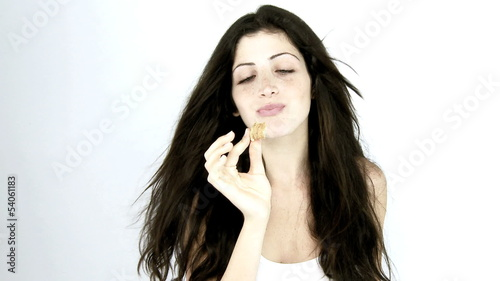 Woman eating sweet croissant against diet