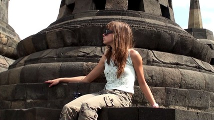 Girl in Borobudur. Mahayana Buddhist Temple, Java, Indonesia.