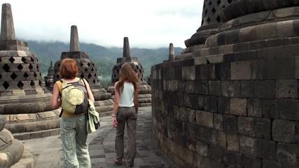 Tourists in Borobudur. Buddhist Temple, Java, Indonesia.