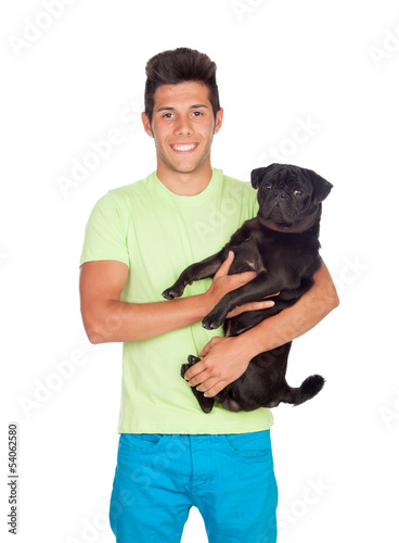 Attractive boy with her pug dog