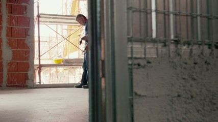 Construction workers, people in new building. Part 1 of 8