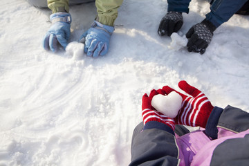 Close-up of Hands in Winter Gloves Playing in the Snow