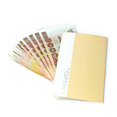 Thailand passbook and Thai money on white background.
