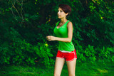 healthy beautiful young brunette woman athlete running outdoors,