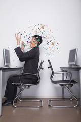 Young Businessman throwing confetti in the office