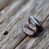 Closeup of coffee beans on grunge wooden background