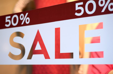 Sale Sign In A Clothing Store Window (With Shallow DoF)
