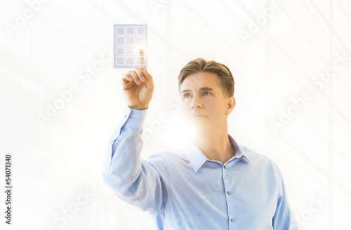 Mature Businessman Touching Virtual Keypad