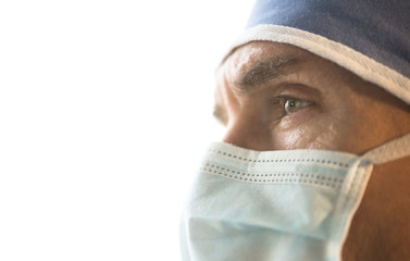 Surgeon Wearing Surgical Mask And Cap Looking Away