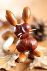 Chestnut and acorn figurine - bunny on wooden table
