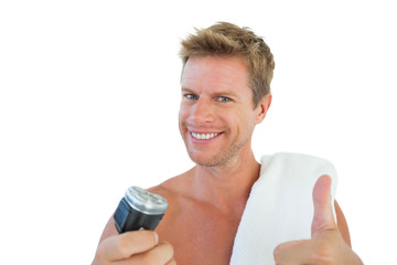 Cheerful man giving thumbs up while holding a razor