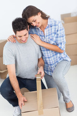 Woman and man wrapping a box