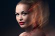 Fashion Blonde Model Portrait with creative Makeup